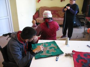 Villagers working with felt